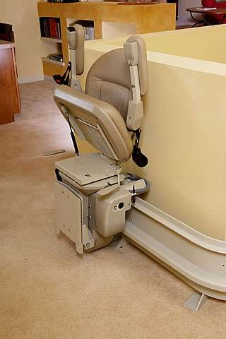 How the Homeadapt Elite Curve stairlift can be conveniently and safely parked on the upstairs landing area, away from the stairs. Also, lift up the seat, arm rests and footrest, to increase the maximum walking area on the landing.