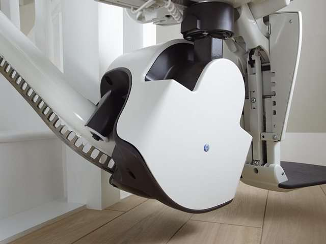 A close-up photo of the rack and pinion mechanism that holds the stair lift chair safely to the stairlift rail.