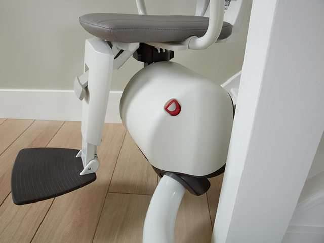 A sideways photo showing how the Flow stair lift can cope with steep angles and bends at the bottom of the stairs as the stairlift starts to rise up the stair lift rail, and still keep the stairlift chair horizontal.