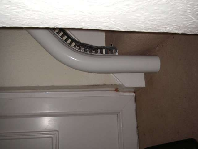 Sideways view of how stair lift rail for Flow stairlift installs conveniately to the floor.