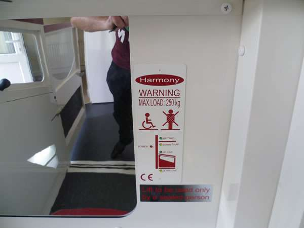 Terry Lifts Harmony through floor wheelchair lift, showing the lift entry / exit door open