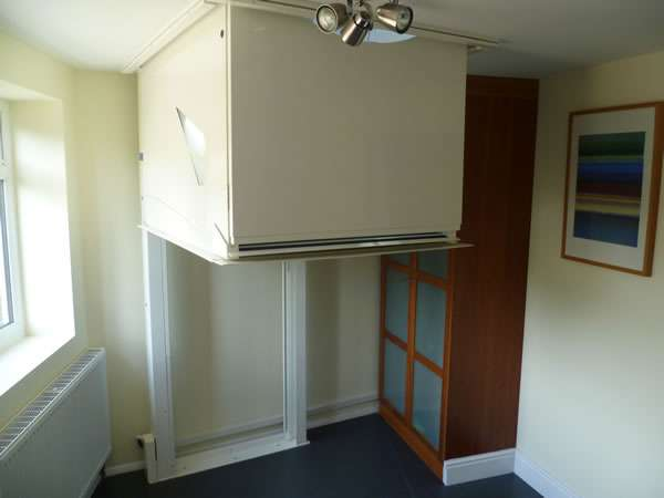 Terry Lifts Harmony through floor wheelchair lift, showing the lift traveling through the ground floor ceiling to the upper floor level