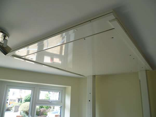 Terry Lifts Harmony through floor wheelchair lift, photo taken from the ground floor, looking up at the ceiling area after the lift has risen to the upper floor. Shows the carefully created tidy join between the lift floor above and the ground floor ceiling