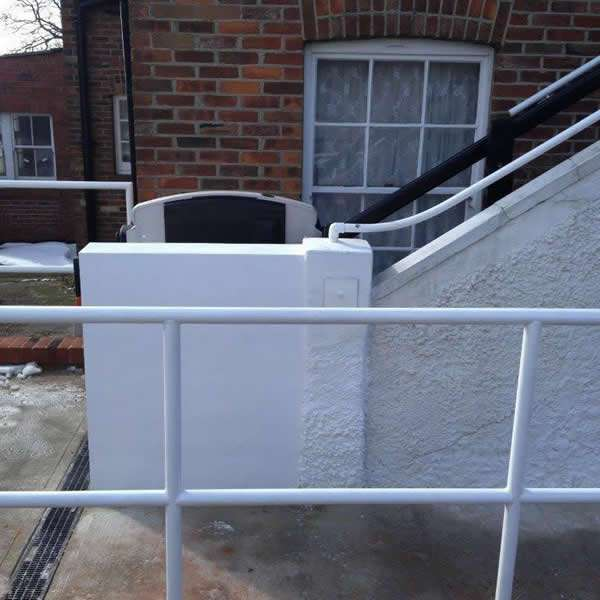 Vimec incline platform lift installation at the bottom of the external steps. A side view shows the Vimec incline platform lift in the raised position to provide easy access to the steps for people who do not require use of the mobility lift
