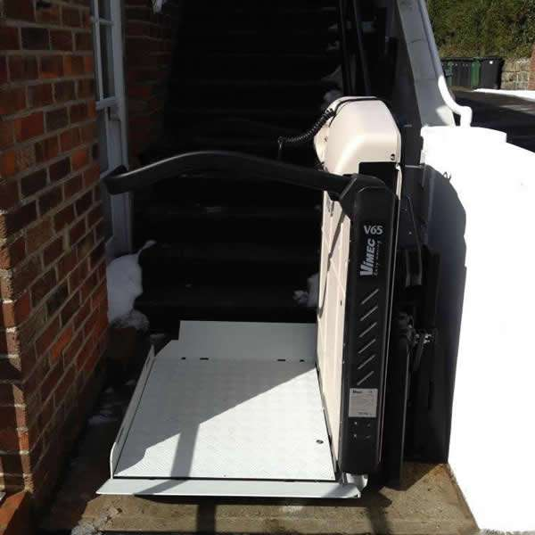 Vimec incline platform lift installation at the bottom of the external steps, shows the Vimec incline platform lift in the lowered position to provide easy access for a wheelchair user to navigate on to the platform ready to be transported up the external steps