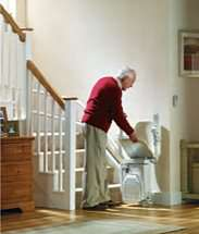 Stannah Siena stair lift for curved stairs. How to use, Step 2, easy fold-up seat, armrests, and footrest