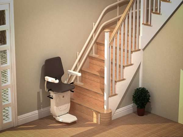 Higher angled view of brown Dolphin Infinity stair lift, parked at the bottom of stairs, with seat, arm rests and footrest in the down position.