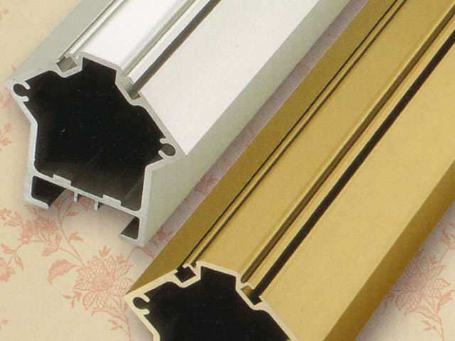 A close-up photo showing two Stannah Saxon 420 stairlift rails: one coloured silver, the other gold coloured.