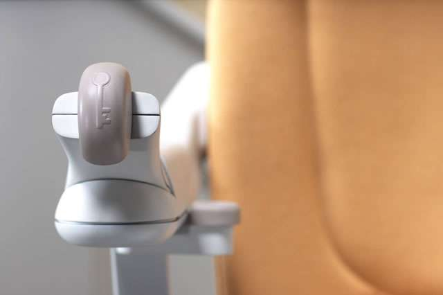 A front view close-up photo of the front of armrest keylock toggle turned to the vertical position, situated on the Stannah Sofia 420 stair lift.