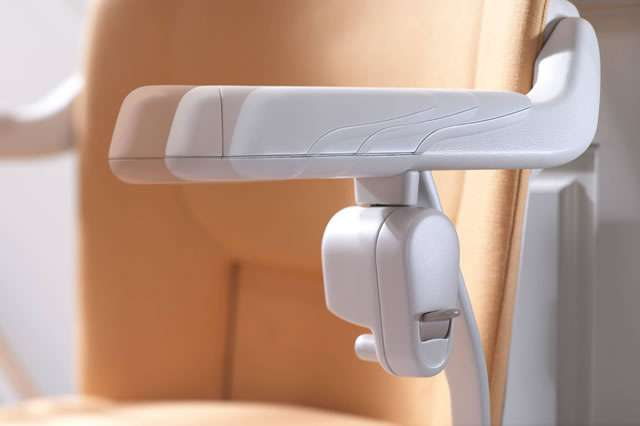 A close-up photo of the toggle button control on the arm rest underside of a Stannah Sofia 420 stair lift for straight stairs.