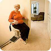 Homeadapt Elite stair lift shown at top of stairs