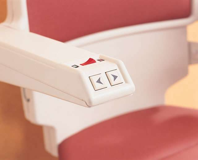 A close-up view of one of the armrests showing the control buttons and indicators.