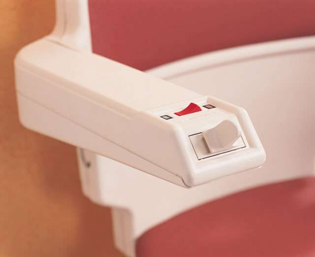 A close-up view of one of the armrests showing the alternative toggle control and indicators.