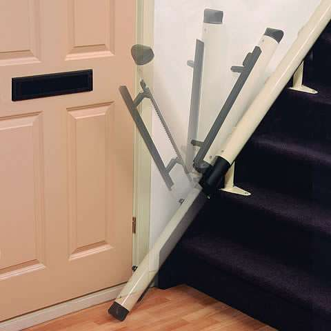 A photo of the bottom of stairs stairlift rail and how it meets the floor. Yet overlaid time-lapse impressions also show how the last stairlift rail section at the bottom of the stairs can be retracted back over and above the stairlift rail, to prevent blocking the adjacent door access.