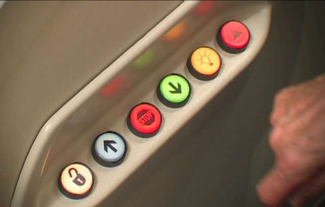 A close-up photo of the control buttons situated inside the cubicle of the Pollock Lifts wheelchair lift.
