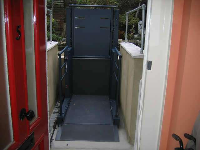 A view of the Wessex Lifts LR800 lifting platform from inside the home looking out to the empty lift in the lowered position, above at street ground level.