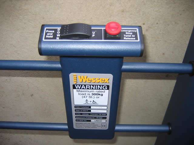 A close-up photo of the Wessex Lifts LR800 low rise lifting platform control panel and buttons.