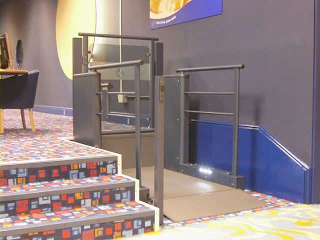 Front angle view of Wessex Lifts steplift LR900 installed in a business premises.