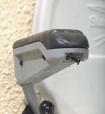 A close-up view of the Stannah 320 outdoor stairlift arm rest toggle joystick control.