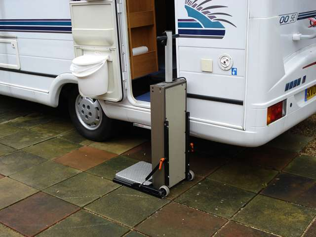 Portable Powerstep lift situated on the ground at the entrance to a caravan or motorhome.