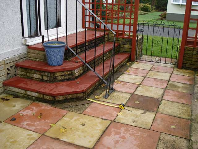 A photo taken from further away of 3 outside steps leading to an entry door of a domestic property. A Powerstep step lift offers a great solution for users to get up and down steps like these.